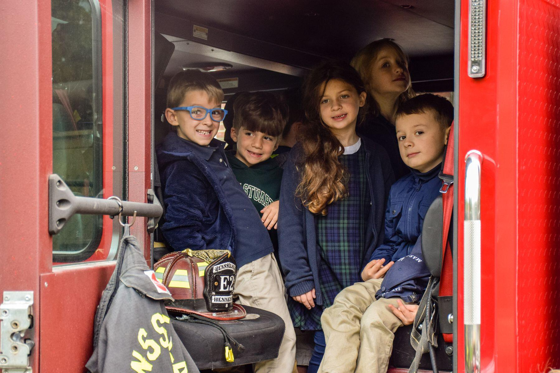 Local Firefighters And Community Helpers Visit Doane